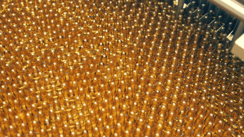The production line for the manufacture of ampules of medicine. A lot of vials of medicine yellow color | Shutterstock HD Video #13794923