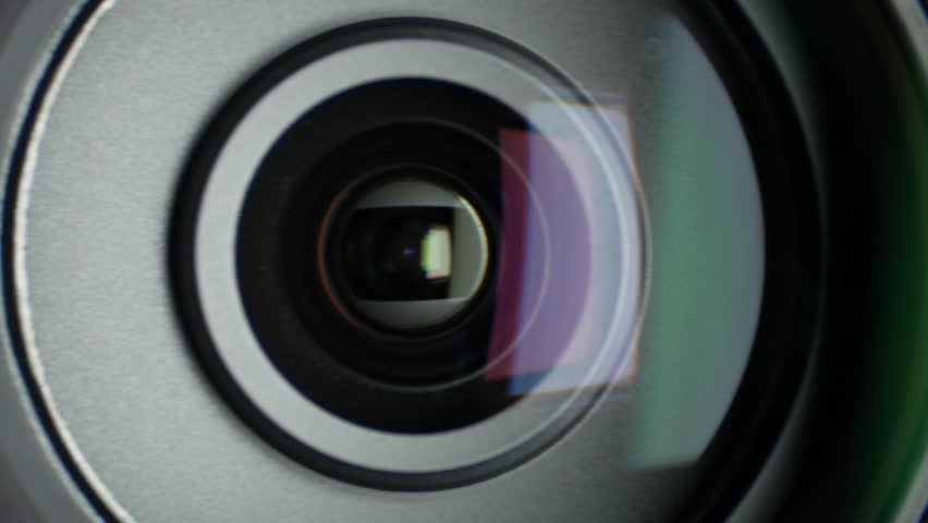 Turn the lens of video camera, showing zoom, close up