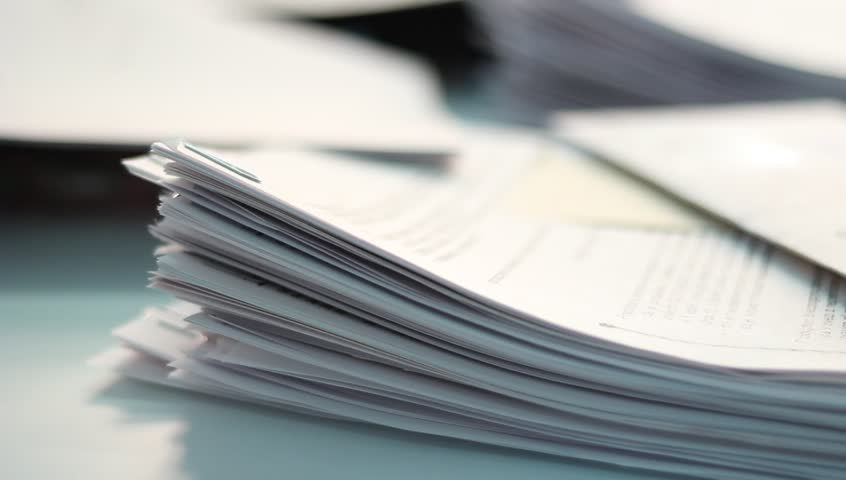 A lot of unsolved work on the table in the office. | Shutterstock HD Video #13834577