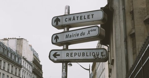 Street sign in Paris, France with directions to Chatelet, City Hall Mairie du 10 and Place de la Republique
