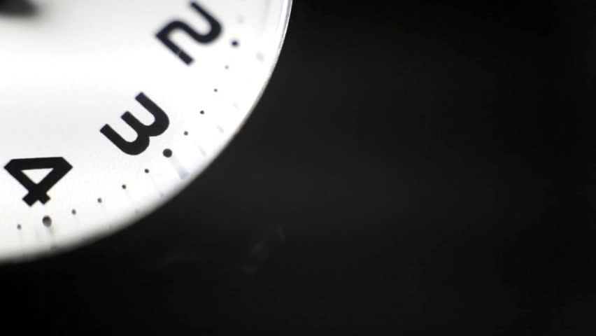 Military stopwatch close up of the hands on the clockwork clock face with selective focus. | Shutterstock HD Video #13856480
