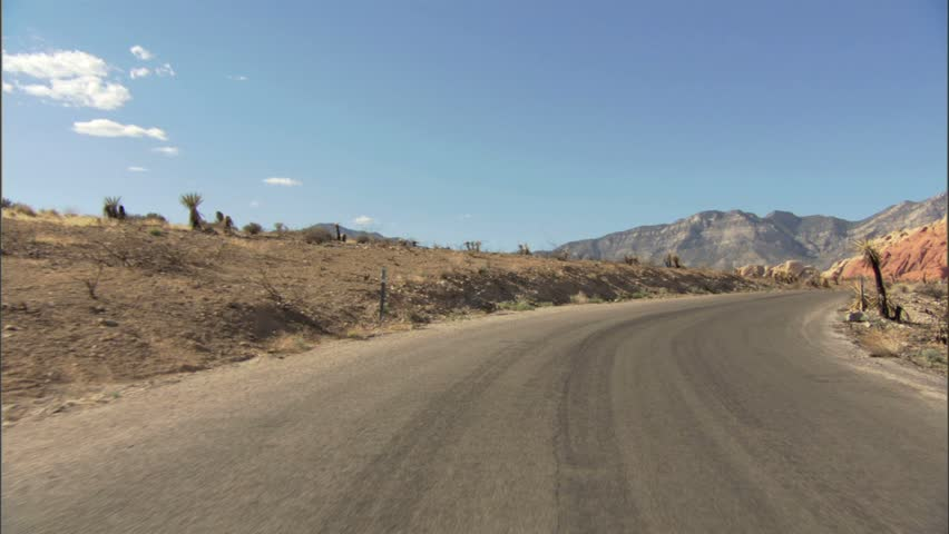 Car driving in arizona towards red rocks | Shutterstock HD Video #1386328
