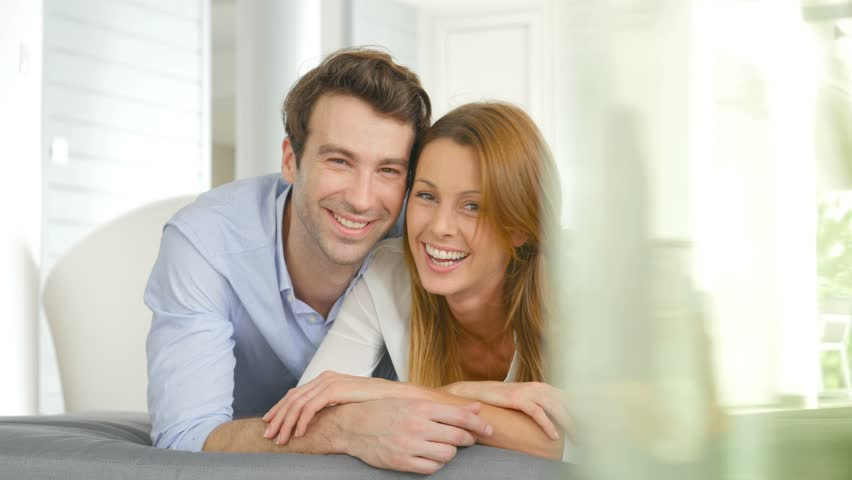 Portrait of cheerful couple laying on cushion | Shutterstock HD Video #13878998