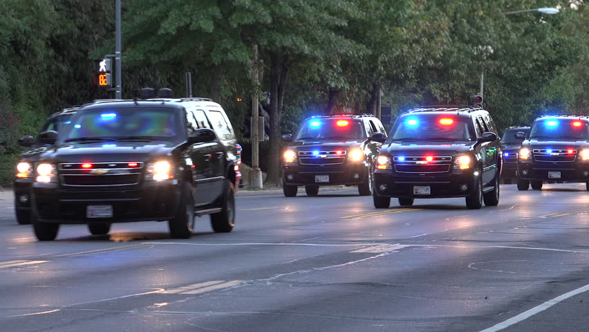 WASHINGTON, DC - DEC. 2015: Motorcade transporting president. Secret Service vehicles race down street, Major highway closed,follow on ambulance -- this is how presidential motorcade travels.