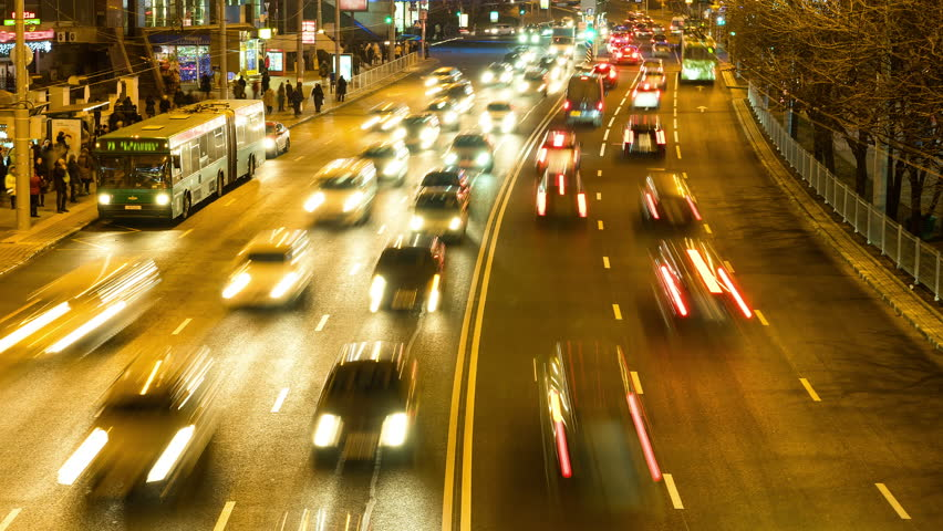 The flow of the cars in the night city. Smooth blurred motion. Timelapse shot. | Shutterstock HD Video #13930736
