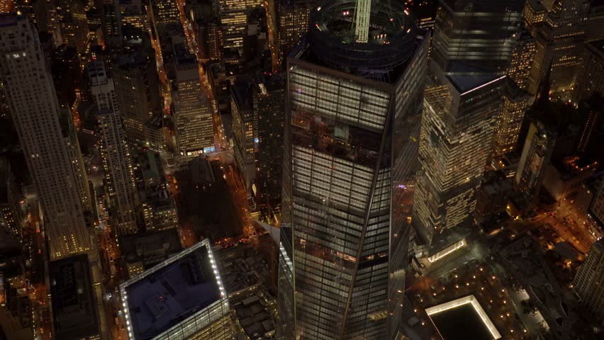 NEW YORK CITY - CIRCA NOVEMBER 2015 - Aerial view of the FREEDOM TOWER and  Wold Trade Center Memorial at night | Shutterstock HD Video #13933832