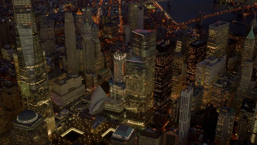 NEW YORK CITY - CIRCA NOVEMBER 2015 - Aerial view of the FREEDOM TOWER and  Wold Trade Center Memorial at night | Shutterstock HD Video #13933841