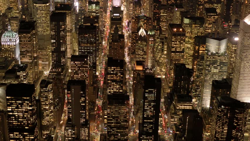 Aerial view of illuminated city metropolis at night. new york city high rise real estate buildings background | Shutterstock HD Video #13946339