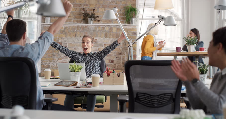 Business woman with arms raised celebrating success watching sport victory on laptop diverse people group clapping expressing excitement in office #13947473