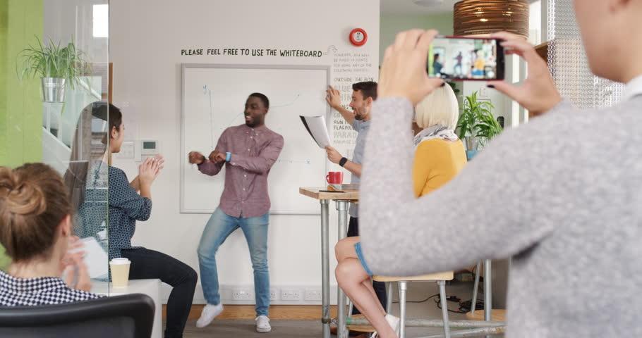 Crazy happy businessman dancing doing victory dance in team meeting celebrating success achievement   Shutterstock HD Video #13948802