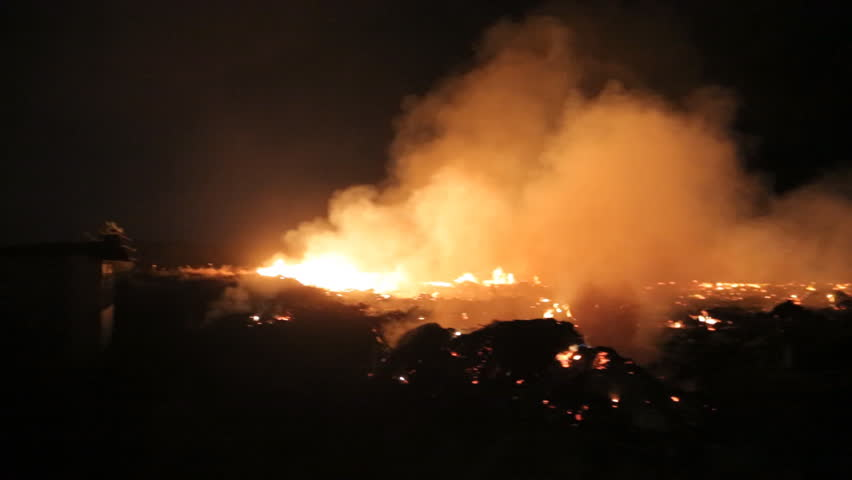 Fire in a field at night | Shutterstock HD Video #13949141