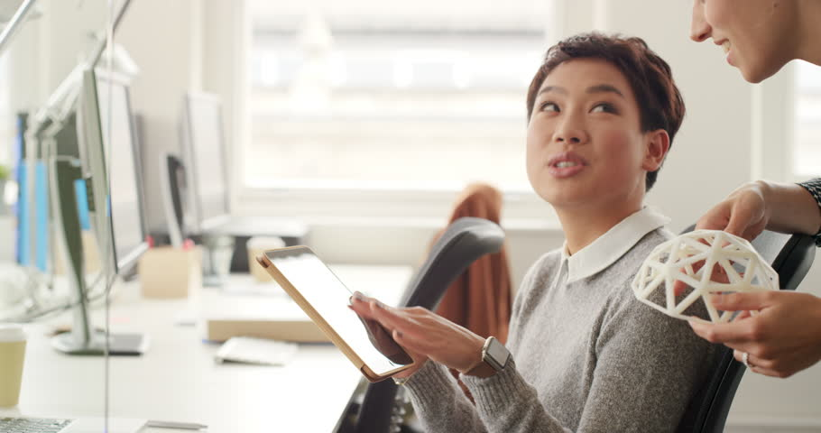 Business woman showing 3d printing object in Creative business team meeting in gender neutral start up office team leader pointing at screen discussing 3d printing technology | Shutterstock HD Video #13949258