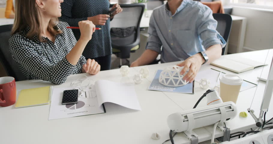 Business woman using tablet app showing 3d printed model of geodesic dome walking through modern office to diverse team meeting | Shutterstock HD Video #13949621