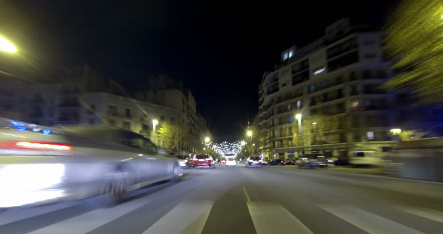 Driving after dark through the streets of Barcelona with Christmas lights. Time Lapse - Trail effect - vehicle shot - subjective view - 4K.(02) | Shutterstock HD Video #13972637