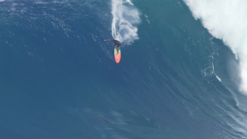 MAUI, HAWAII.  January, 15 2016: Big Wave Surfing Wipeout. Surfer Crashes on Giant Ocean Wave Surfing Jaws on North Shore in Hawaii.
