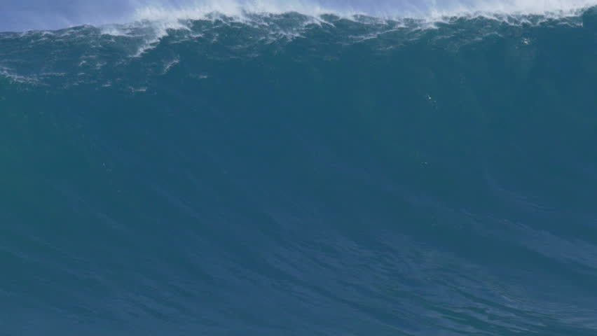 Giant Ocean Wave Breaking in Hawaii. Slow Motion HD. Surfing Jaws