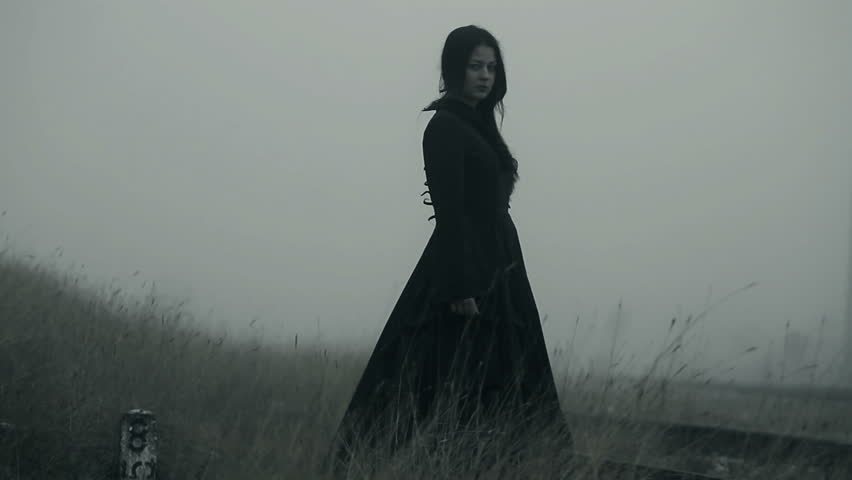 Horror scene of a scary woman in the fog