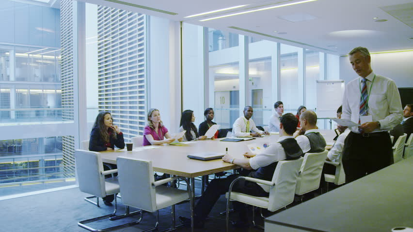 4k / Ultra HD version Diverse business team in boardroom meeting in a large contemporary office building Shot on RED Epic | Shutterstock HD Video #14005376