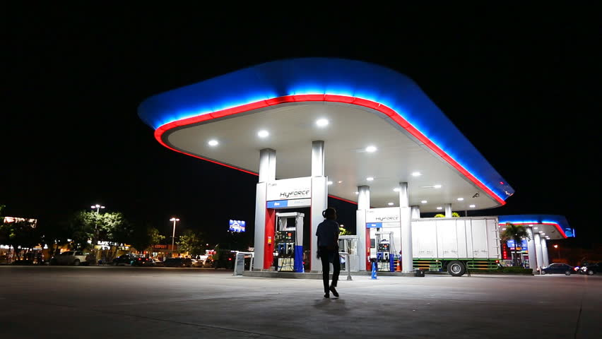 CHONBURI,THAILAND- NOVEMBER 20, 2015: PTT gas station with vehicle on night time at high way road during Chonburi city to Bangkok city , Chonburi ,Thailand    Shutterstock HD Video #14008733