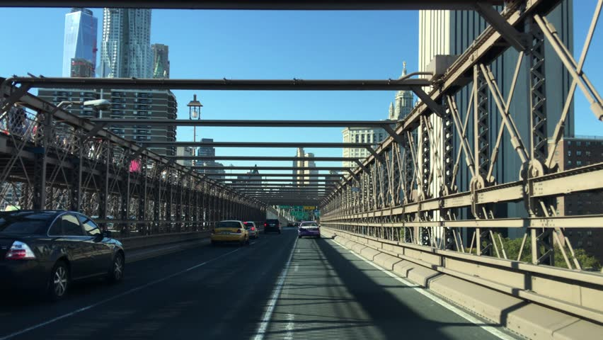 New York City - United States, October 2015: Traffic on Brooklyn Bridge in a sunny day   Shutterstock HD Video #14017199