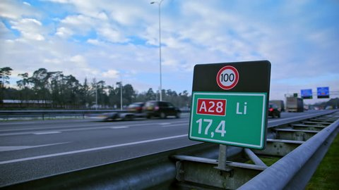 Wide shot of speed sign next to highway in the Netherlands.