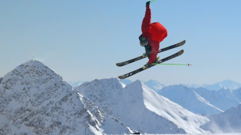WS TS SLO MO View of free skier jumping scene with snowy mountains / Stubai, Central Eastern Alps, Innsbruck, 13/09/2014