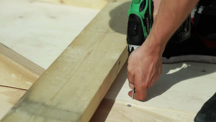 Carpenter works screwdrivers | Shutterstock HD Video #14032190
