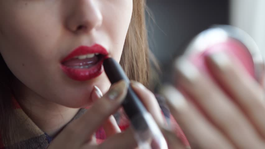 Young woman red lips and lipstick | Shutterstock HD Video #14035547
