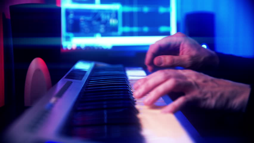 Hands of Musician Playing Keyboard in Color Glow | Shutterstock HD Video #14037407