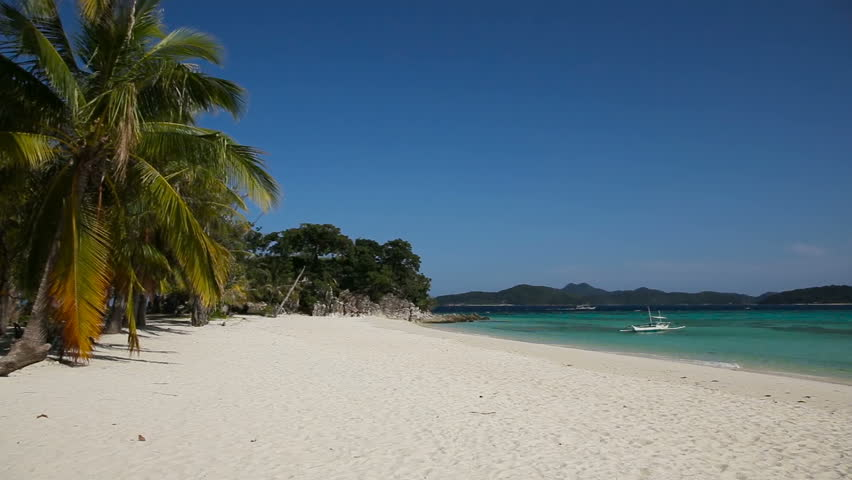 Tropical white sand beach,blue sky, clouds.Wave running on coast of tropical island.Concept travel.Landscape of a tropical beach with a boat.Beautiful tropical beach with clear blue water.   Shutterstock HD Video #14037611