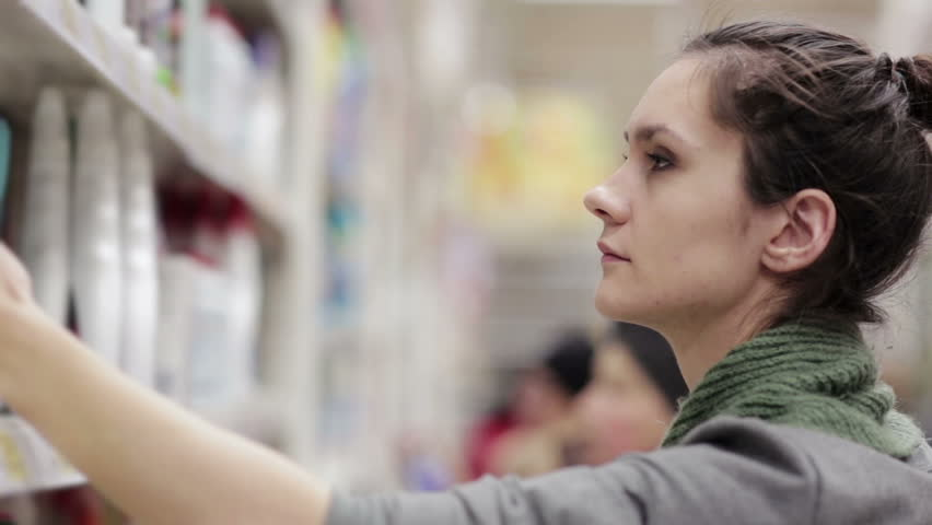 Woman chooses household chemicals in the store | Shutterstock HD Video #14050586
