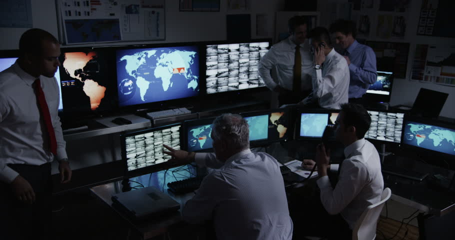 4k / Ultra HD version Time lapse of personnel who are manning the stations within a busy control room. This could be a station or airport control room. It could be a power station or control facility. #14050709
