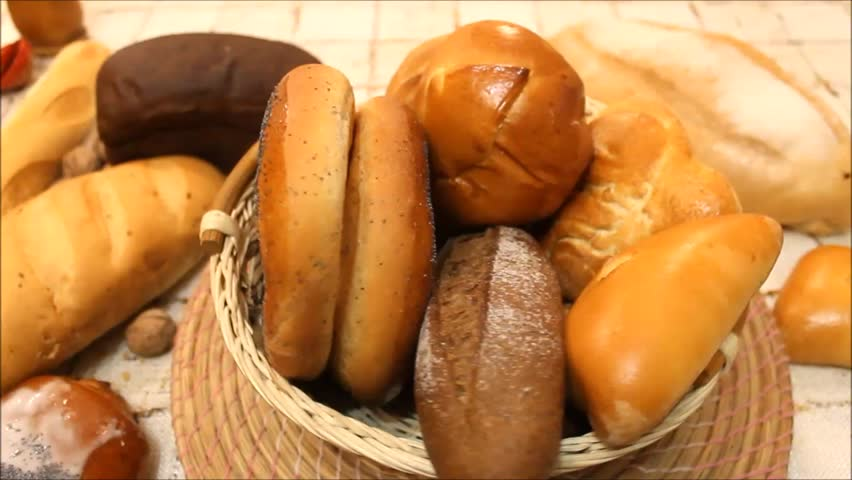 Bread in the rotating basket on a table | Shutterstock HD Video #14088335