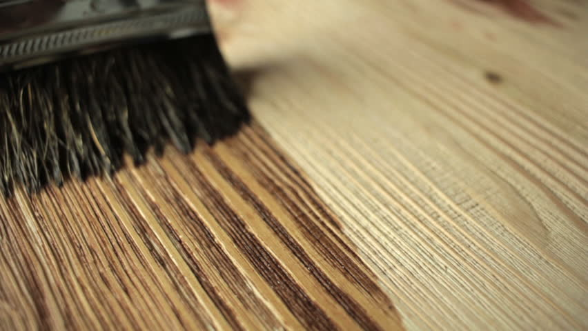 Close-up Wood painting with a brush with the brown color Royalty-Free Stock Footage #14117735