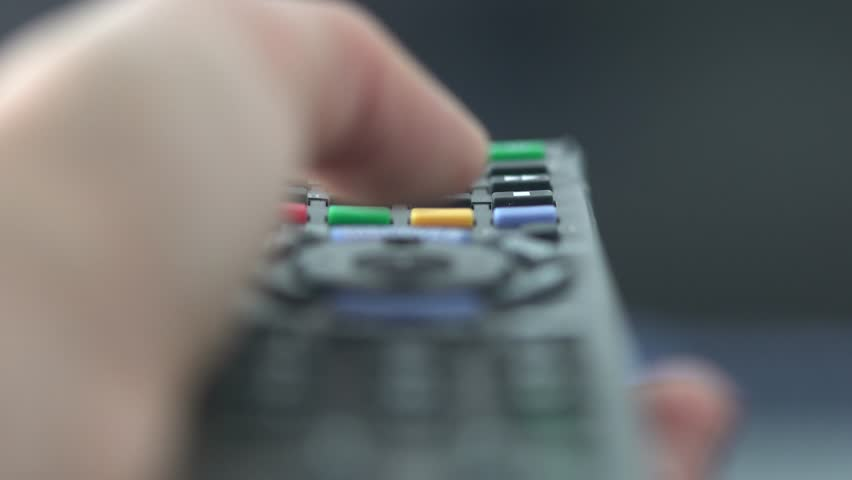 Close Up of TV Remote Control while changing channels 4K.  | Shutterstock HD Video #14122520