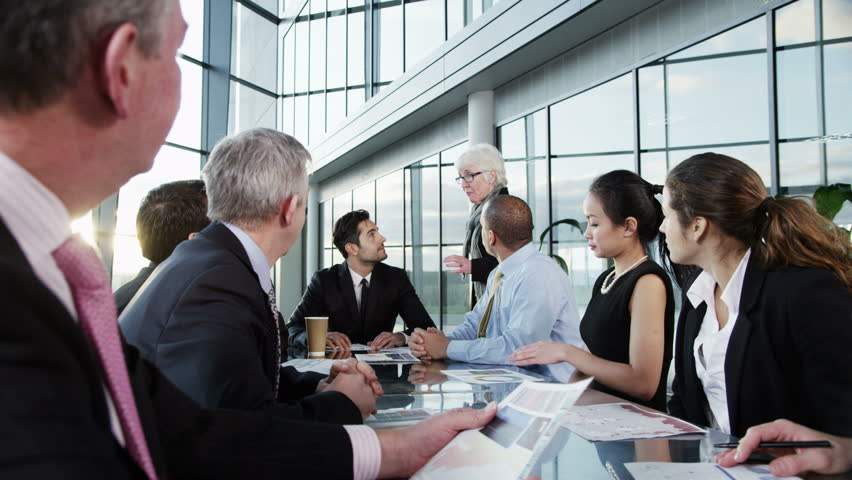 4k / Ultra HD version A confident and attractive business team are holding a meeting in a light, modern office building. They are discussing ideas for their business development. Shot on RED Epic   Shutterstock HD Video #14127371