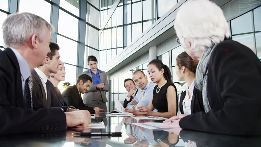 4k / Ultra HD version A confident and happy business team are holding a meeting in a modern office building. They are discussing ideas, applauding a comment from one of the group. Shot on RED Epic   Shutterstock HD Video #14127410
