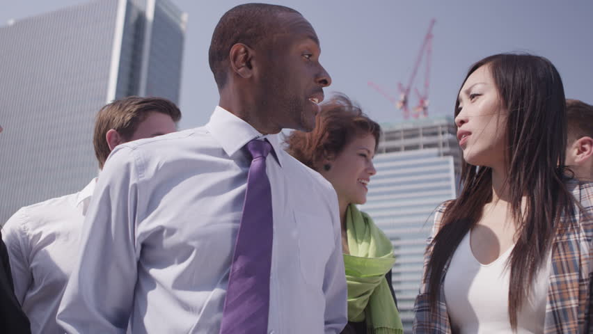4k / Ultra HD version Portrait of a cheerful team standing on the rooftop terrace of a city office building with a view of the city skyline behind them. In slow motion. Shot on RED Epic | Shutterstock HD Video #14147075
