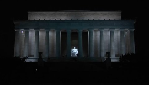 The Lincoln Memorial in Washington DC with visitors approaching, from a distance.