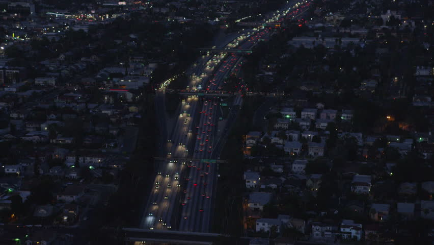 4k / Ultra HD version Aerial view of Los Angeles, California at night. Helicopter shot over homes and business buildings in American suburbs. Shot on RED Epic | Shutterstock HD Video #14167997