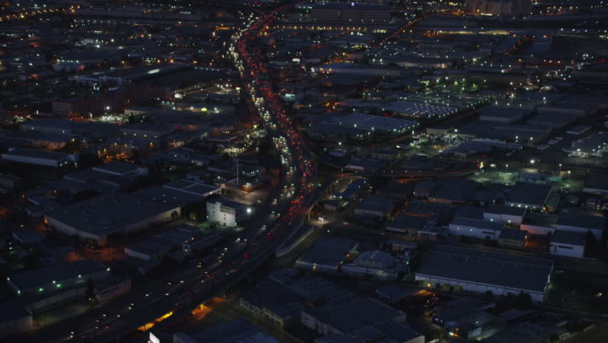 4k / Ultra HD version Aerial view of Los Angeles freeway traffic at night. California helicopter shot over homes and business buildings in American suburbs. Shot on RED Epic | Shutterstock HD Video #14168108