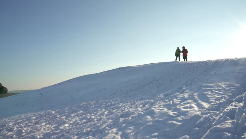 4k footage, active senior couples enjoying winter day outdoors with sled and tea