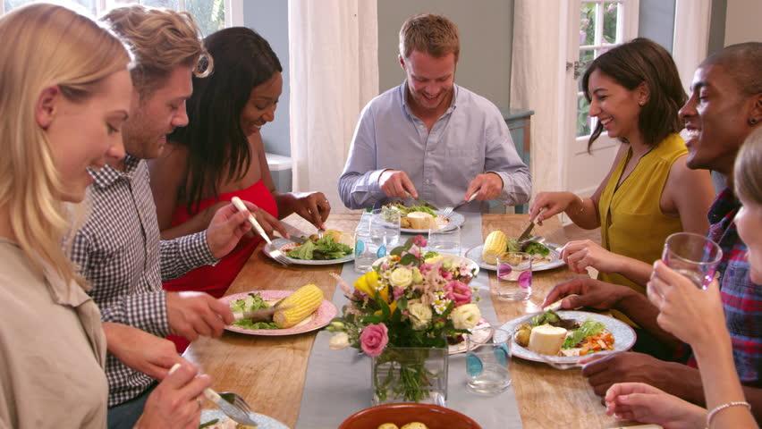 Friends Sitting Around Table at Stockvideoklipp (helt royaltyfria) 14170322 | Shutterstock