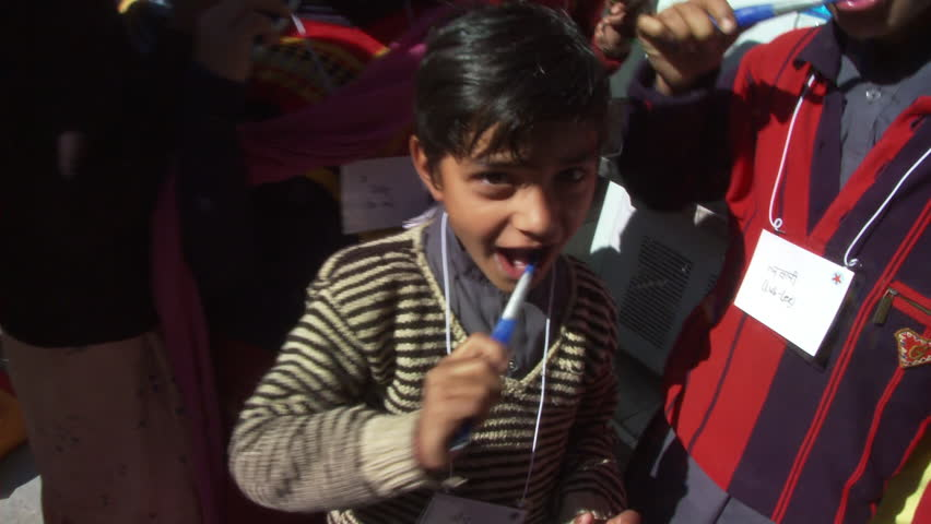 Chamba, India - CIRCA 2013 - School girls brushing teeth   Shutterstock HD Video #14196272