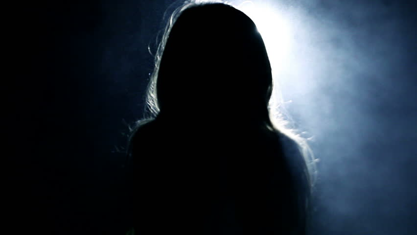 Horror.  Girl in a dark room in front of bright light from the lantern. #14203973