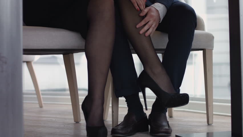 Young Couple Flirting with Legs : video stock a tema (100% royalty free)  14216138 | Shutterstock