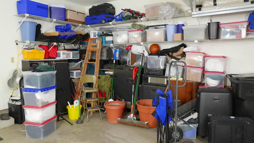 Messy suburban garage dolly in shot.  Object brand names and logos were covered.   | Shutterstock HD Video #14230310