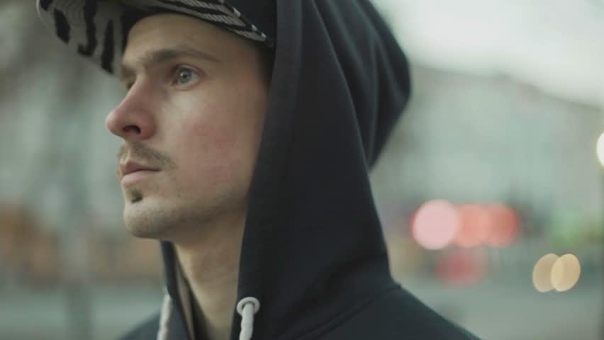 Man in a cap pulls earphone close-up | Shutterstock HD Video #14265002