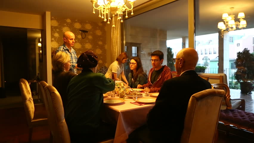 Happy family sit  around the dinner table all together, they have good time and nice atmosphere at home. #14275691