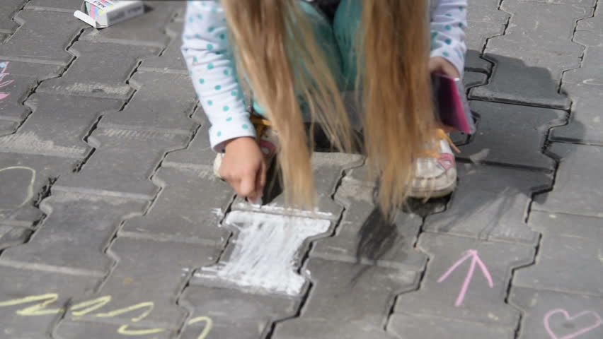 Girl drawing with chalk in the street | Shutterstock HD Video #14280670